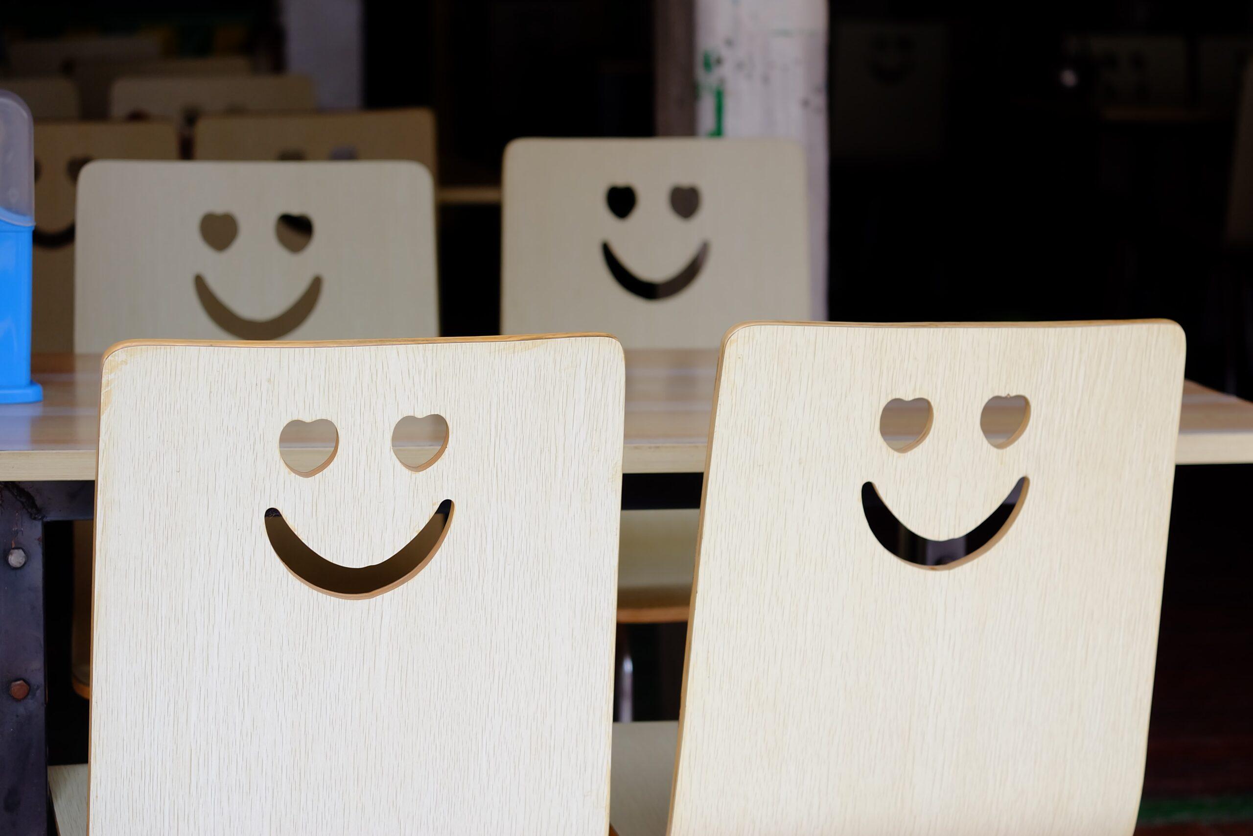 four wooden rectangle smiley faces